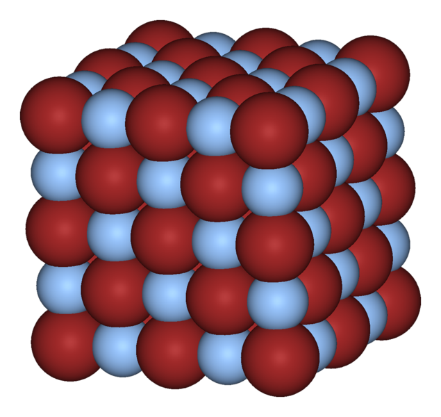 Figure 2 - The crystal structure of silver bromide.  The silver atoms are the red spheres the bromide atomes are the pale blue spheres.  Form the Wikicommons and in the public domain.