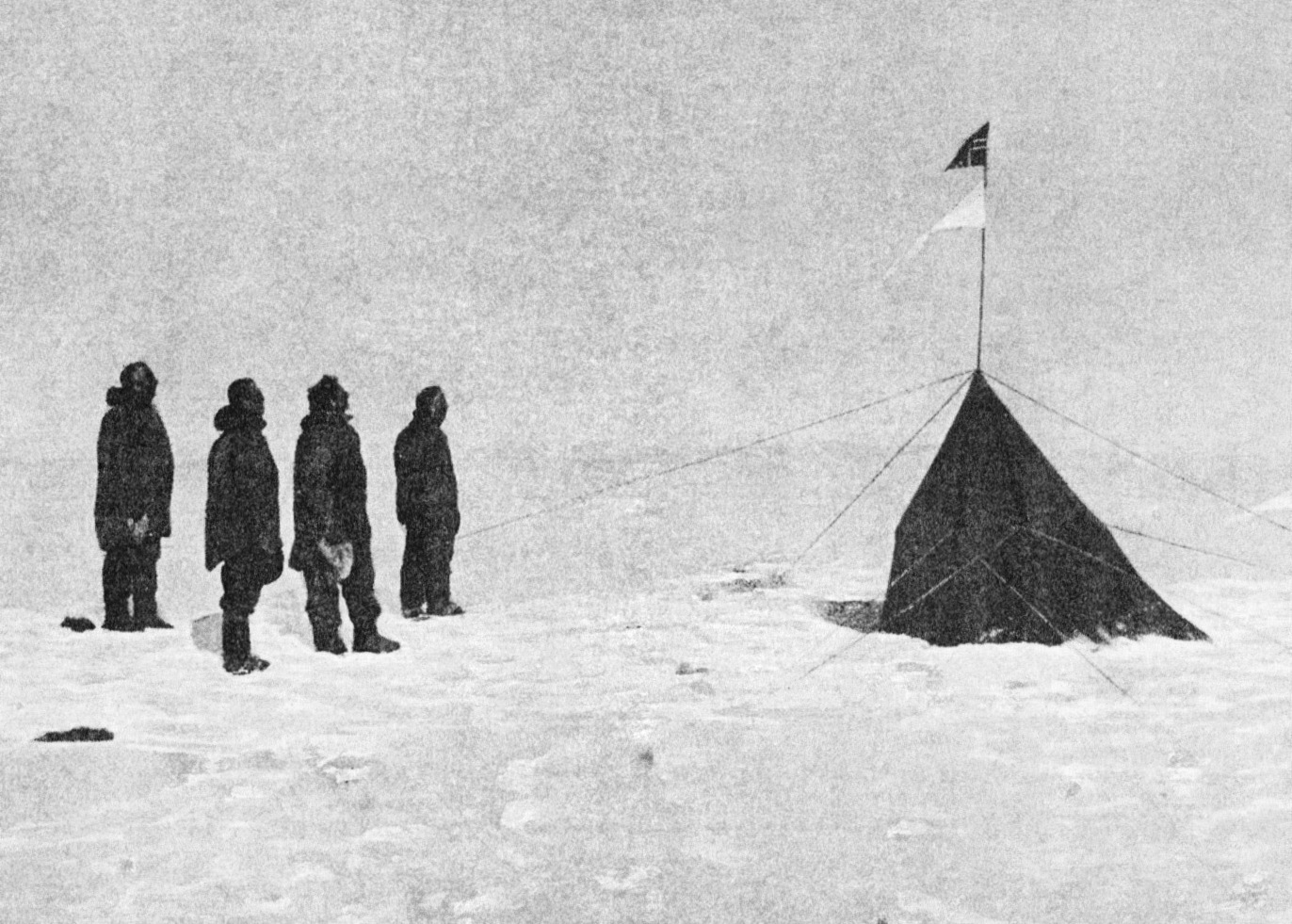 "Figure 1 - Roald Amundsen, Helmer Hanssen, Sverre Hassel and Oscar Wisting (l–r) at the South Pole standing before ""Polheim"", the tent erected at the South Pole on 16 December 1911. Photograph by Olav Bjaaland, the fifth team member.  Originally published in Amundsen's ""The South Pole.""  From the Wikicommons and in the public domain."