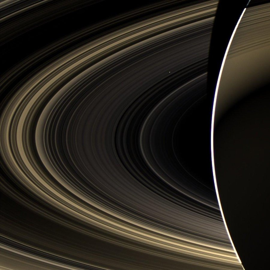 Figure 1 - Venus glimmering brightly through the rings of Saturn taken by the Cassini-Huygens satellite on November 10, 2012 from NASA and in the public domain.