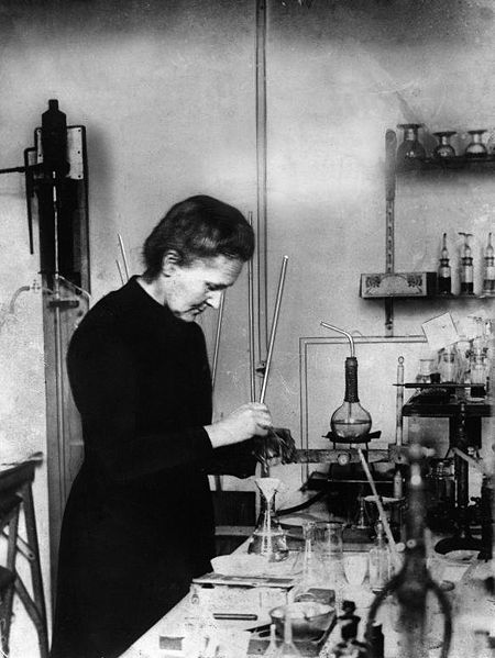 Figure 2 - A later laboratory picture of Marie Curie.  From the Wikicommons and in the public domain.