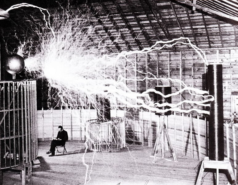 Figure 1 - Nikola Tesla in his laboratory.  From the Wikicommons and in the public domain.