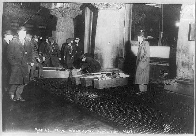 Figure 3 - Bodies of the victims from the Washington Place fire being placed in coffins fro the journey to the morgue, March 25,1911, from the Loc and the Wikicommons in the public domain.