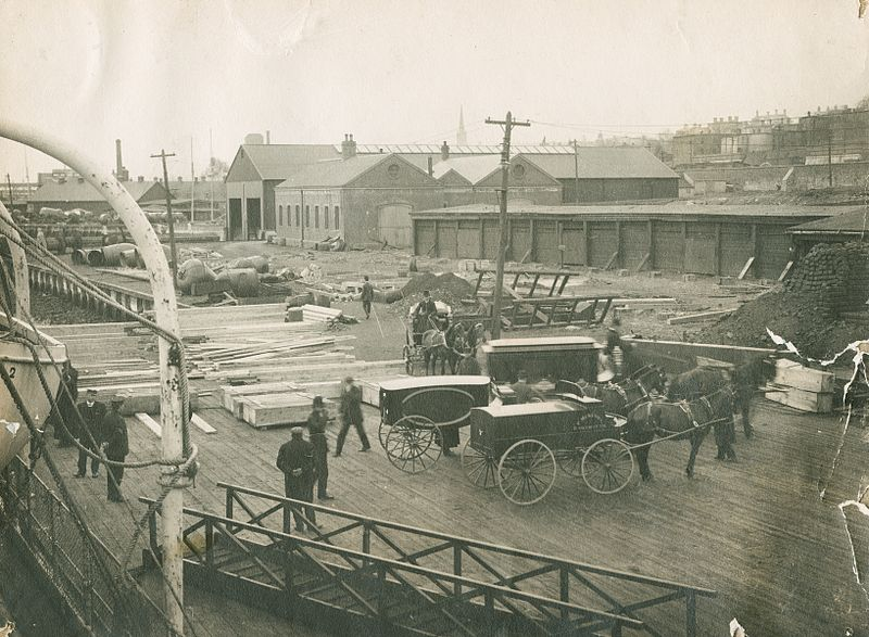 Figure 1 - The need to witness, hearses in Halifax, NS awaiting the arrival of drowning victims of the Titanic, 1912. Photograph from the Wikimediacommons and in the public domain.  Original photograph attributed to attributed to William J. Parker or William Mosher.