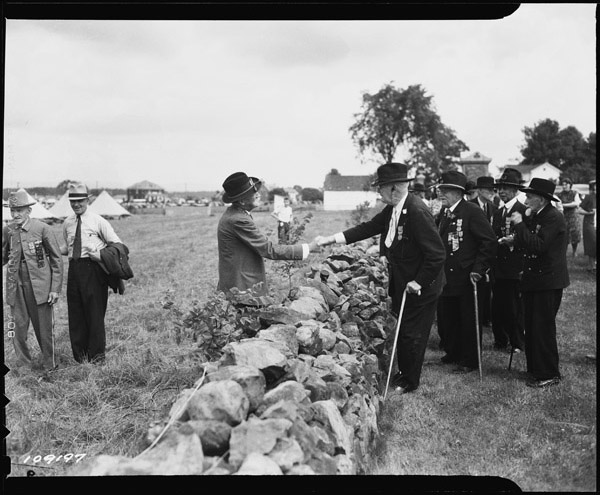 Figure 5 - The blue and the grey meet for the last time at Gettysburg, July 1938, from the National Arcives and in the public domain.