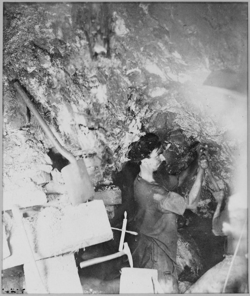Figure 1 -  Miner working inside the Comstock Mine, Virginia City, Nev. Taken by O'Sullivan using the glare of burning magnesium for a flash of light, 1867--68, form the Wikimedia Common and the US National Archives, in the public domain.