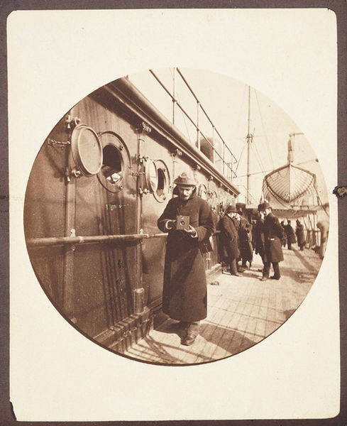 Figure 1 -  George Eastman with Kodak #2 Camera on the S.S. Gallia in 1890 by Frederick Church, image from the Wikimedia Commons and in the public domain.
