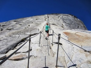Figure 2 - SuzyR climbing the cables up Half Dome, (c) SR 2013 and  reproduced with permission.