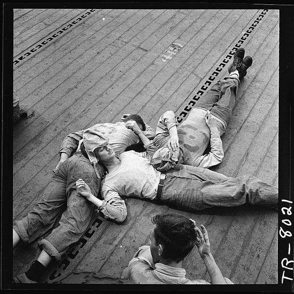 "Figure 1 - Edward Steichen, ""Sailors Sleeping on the Deck of the USS Lexington,"" 1943, from US NARA and in the public domain,"