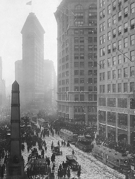 Armistice Day, November 11, 1918 at Madison Square in NYC, from the Wikimedia Commons and in the public domain.