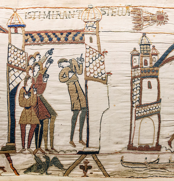 Figure 1 - From the Bayeux Tapestry (c 1070), the appearance of Halley's Comet in 1066 AD brings fear to the minds of the troops of William the Conquerer.  Image uploaded by Mirabella to the Wikipedia Commons and in the public domain.