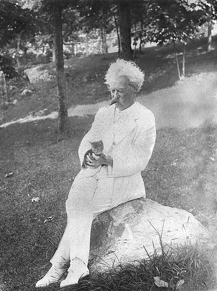 Figure 2 - Mark Twain with one of his cats, 1907. By Underwood and Underwood, from the NY Times Arcghives and the Wikimedia Commons, in the public domain.