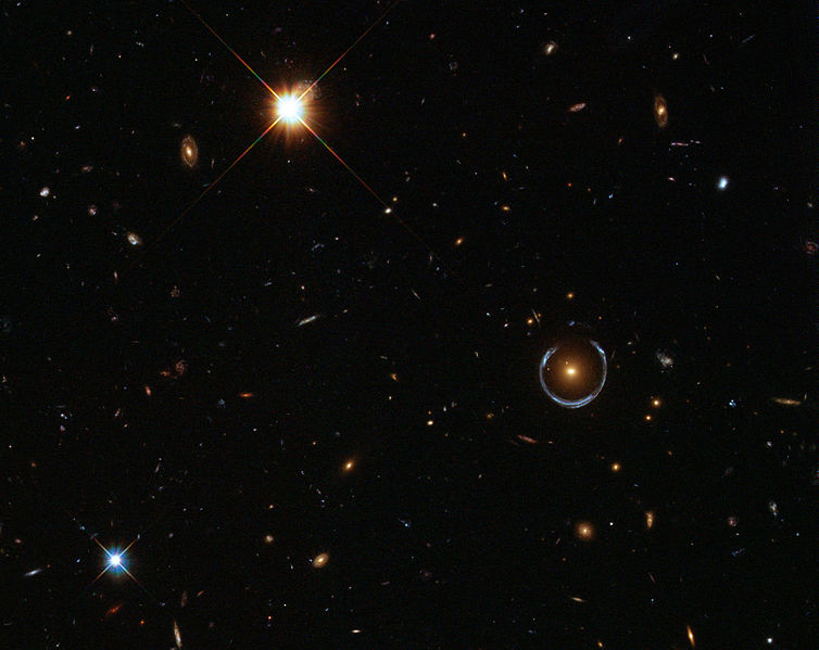 Figure 1 - Einstein Ring due to gravitational lensing (lower left) due to LRG 3-757, 2011 from ESA/Hubble & NASA via the Wikipedia and in the public domain.