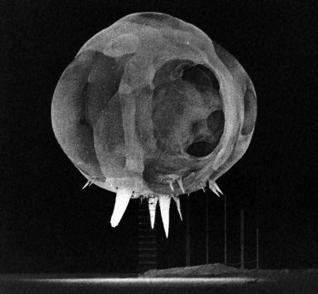 Figure 1 -   Nuclear explosion photographed by rapatronic camera less than 1 millisecond after detonation. The fireball is about 20 meters in diameter. The spikes at the bottom of the fireball are due to what is known as the rope trick effect.  From the Wikimedia Commons and in the ublic domain because the image was taken by the government of the United States.