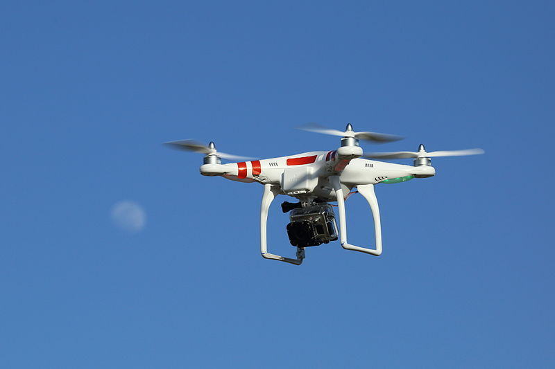 Figure 1 - A photo drone positioned beside the moon.  Image from the Wikimedia Commons by Don McCullough and put into the public domain under creative commons attribution license.