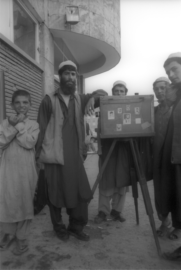Figure 1 - An Afghan Street Photographer in 2001.  From the Wikipedia Commons, picture by User bluuurgh and in placed in the public domain by the photographer under creative commons license.