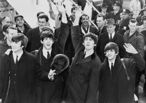 Figure 1 - The Beatles waving to fans on their arrival at JFK Airport in New York City on Feb. 7, 1964.  UPI photograph, photographer unknown, from the LOC via the Wikimediacommons and in the public domain.