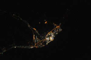 Figure 1 - The Sochi Olympic Village photographed at night from the USS.  Zoom in on the stadium and you can see the Olympic Torch.  Photograph from NASA and in the public domain.