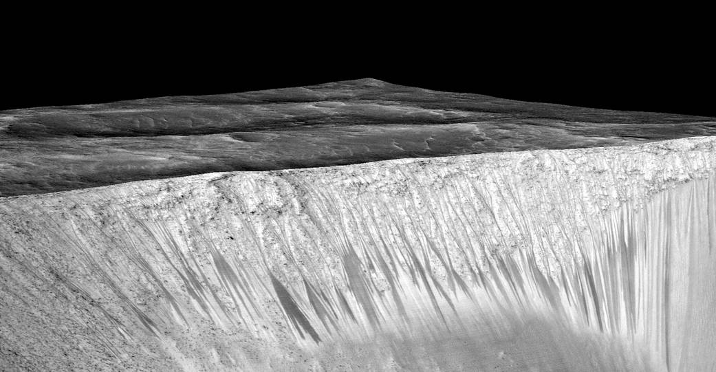 Figure 1 - water streaks on Mars, from NASA and in the public domain.
