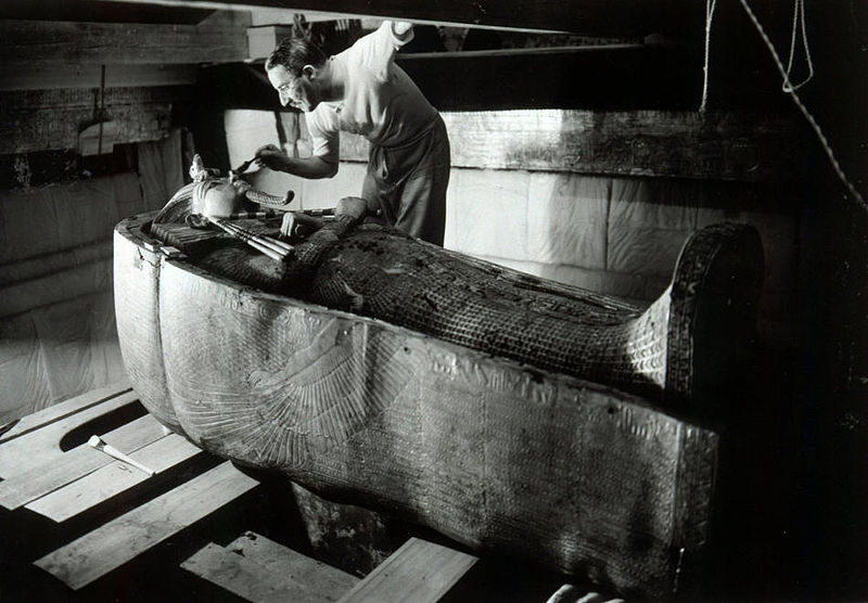 Figure 1 - Harry Burton, Howard Carter examining the sarcophogus of King Tutanhkamun, 1921. In the public domain in the United States because of its age.