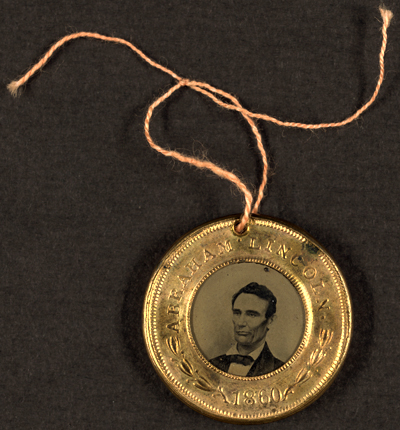 Lincoln campaign button from the 1860 Presidential Election. From the Wikipedia and the US LOC, in the public domaign.