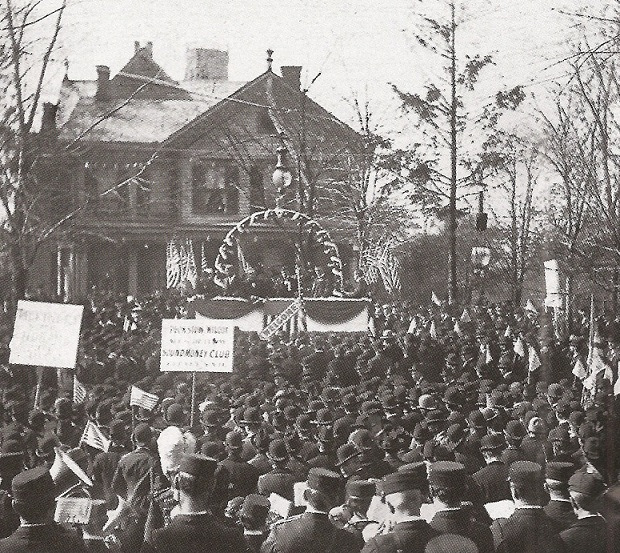 "Figure - McKinley campaigning in 1896 from the porch of his ""Campaign House."" From the US LOC and in the public doman because of its age."