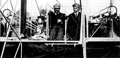 Figure 1 - TR on a biplane with Arche Hoxsey, the first US President to fly. From the US LOC and in the public domain because of its age.