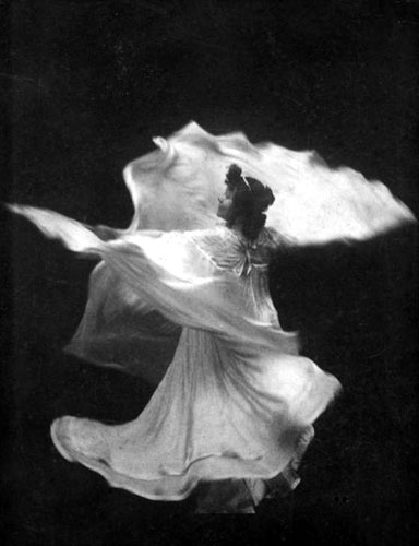 Figure 2 - Loie Fuller by I. W. Taber. In the public domain in the United States because of its age.