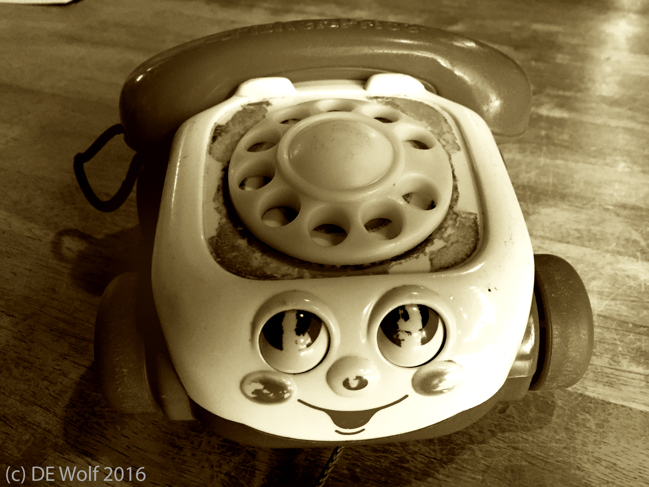 Figure 1 - Toy phone a study in obsolescence, IPhone photograph, (c) DE Wolf 2016.
