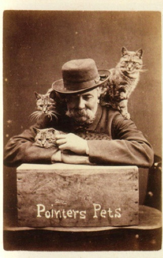 Figure 1 - Harry Pointer with his Brighton Cats c. 1870. In the public domain in the United States because of its age.