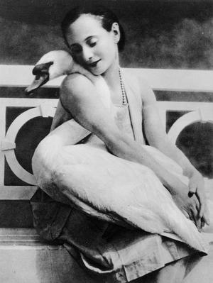 Figure 1 - Anna Pavlova with her swan Jack at Ivy House 1905. Credit Lafayette Photography Studios London. In the public domain in the United States because of its age.