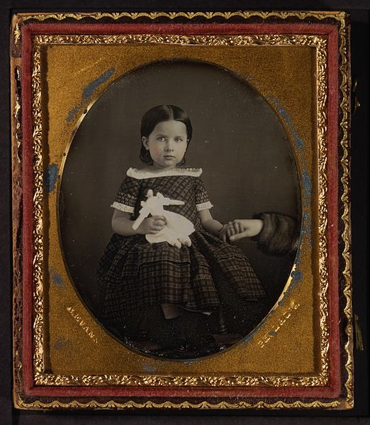 Figure 1 - Daguerreotype by C. Evans of a girl with her doll and holding her mother's hand. From the Wikimedia Commons and the George Eastman House (online), no known copyrights.